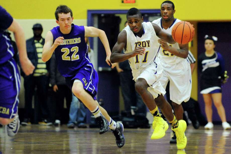 Troy's Dyaire Holt, center, drives up court as CBA's Matt Hamel, left, defends during their basketball game on Friday, Dec. 6, 2013, at Troy High in Troy, N.Y. (Cindy Schultz / Times Union) Photo: Cindy Schultz / 00024920A