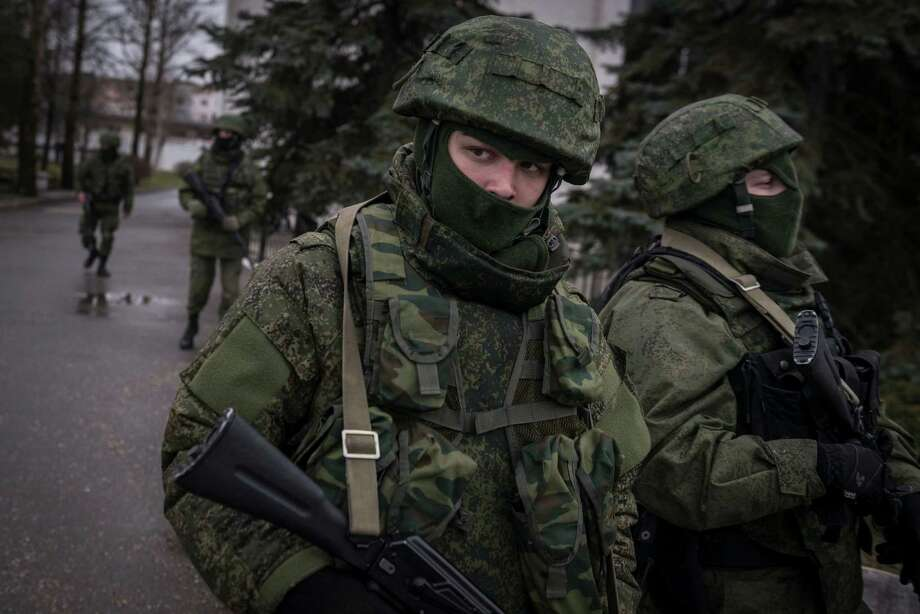Armed men patrol the street outside SimferopolâÄôs airport in the Crimea region of Ukraine, Feb. 28, 2014. As the possibility of a showdown between UkraineâÄôs fledgling government and the Kremlin appeared to grow Friday, armed men whose uniforms bore no insignia took up positions at the Simferopol and Belbek airports as Interior Minister Arsen Avakov warned of a direct provocation, but there was no sign of any violence. (Sergey Ponomarev/The New York Times) Photo: SERGEY PONOMAREV, STR / NYTNS