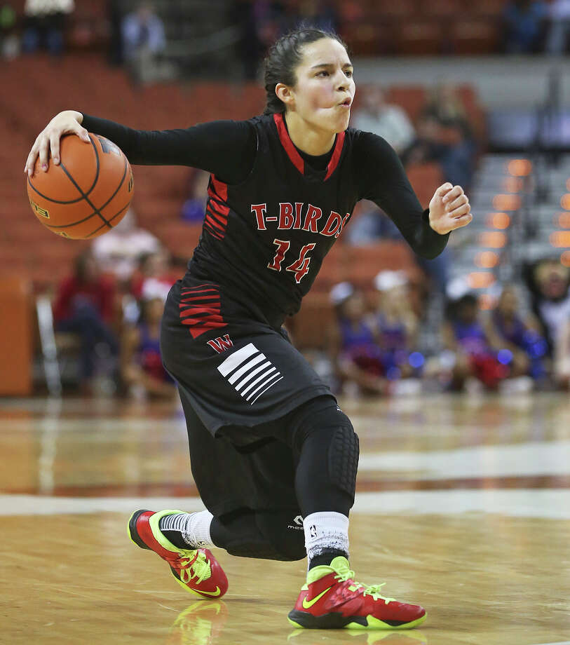 Amber Ramirez pulls up on the dribble as Wagner plays Duncanville in the semifinals of the state 5A basketball tournament at the Erwin Center in Austin  on February 28, 2014. Photo: TOM REEL