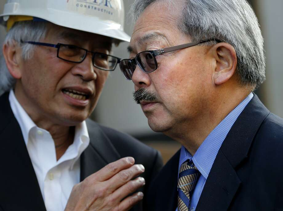 Mayor Ed Lee (right) listened to James Ho, a member of the hospital Board of Trustees Tuesday February 25, 2014 in San Francisco, Calif. San Francisco Mayor Ed Lee appeared at a ceremony marking the final steel beam installment at the new Chinese Hospital being built in Chinatown. Photo: Brant Ward, The Chronicle