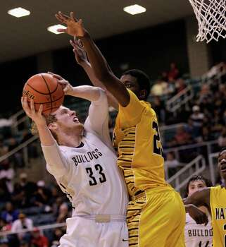 Nederland's Colton Weisbrod is pressured by Marshall's Elliot Taylor during action from a Class 4A Region III boys basketball semifinal game Friday, Feb. 28, 2014 at the Merrill Center. Fort Bend Marshall won 53-50. Photo: Bob Levey / ©2014 Bob Levey