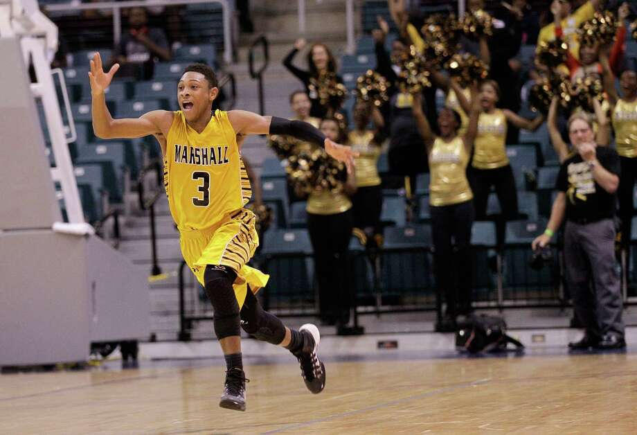 Fort Bend Marshall 53, Nederland 50Marshall's Jadier Ricahrdson celebrates at the buzzer during action from a Class 4A Region III boys basketball semifinal game Friday, Feb. 28, 2014 at the Merrill Center. Fort Bend Marshall won 53-50. Photo: Bob Levey / ©2014 Bob Levey