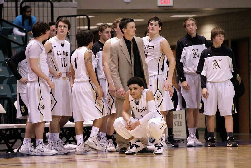 Nederland watches as Marshall celebrates their win during action from a Class 4A Region III boys bas