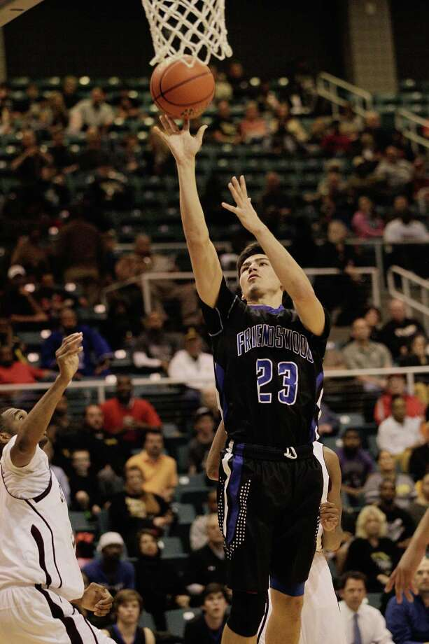 Friendswood's Kelby Schimming puts back an offensive rebound for a basket during action from a Class 4A Region III boys basketball semifinal game Friday, Feb. 28, 2014 at the Merrill Center. Beaumont Central won 46-45. Photo: Bob Levey / ©2014 Bob Levey