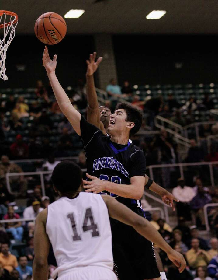 Friendswood's Kelby Schimming drives to the basket for a layup past  Beaumont Central's Garrison Mitchell during action from a Class 4A Region III boys basketball semifinal game Friday, Feb. 28, 2014 at the Merrill Center. Beaumont Central won 46-45. Photo: Bob Levey / ©2014 Bob Levey