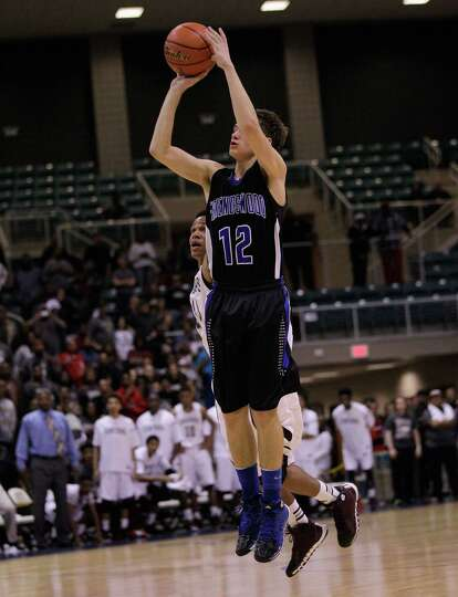 Friendswood's Chris Collins three point shot attempt at the buzzer comes up short during action from