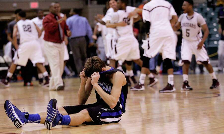 Friendswood's Chris Collins sits on the court after his three-point shot attempt at the buzzer came