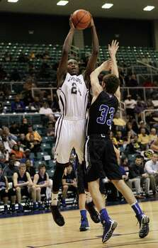 Beaumont Central's E'Torrion Wilridge shoots over Friendswood's Zach Wilson during action from a Class 4A Region III boys basketball semifinal game Friday, Feb. 28, 2014 at the Merrill Center. Beaumont Central won 46-45. Photo: Bob Levey / ©2014 Bob Levey