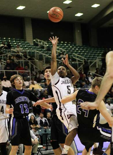 Beaumont Central's Jacory Guillory puts up a shot in traffic during action from a Class 4A Region II