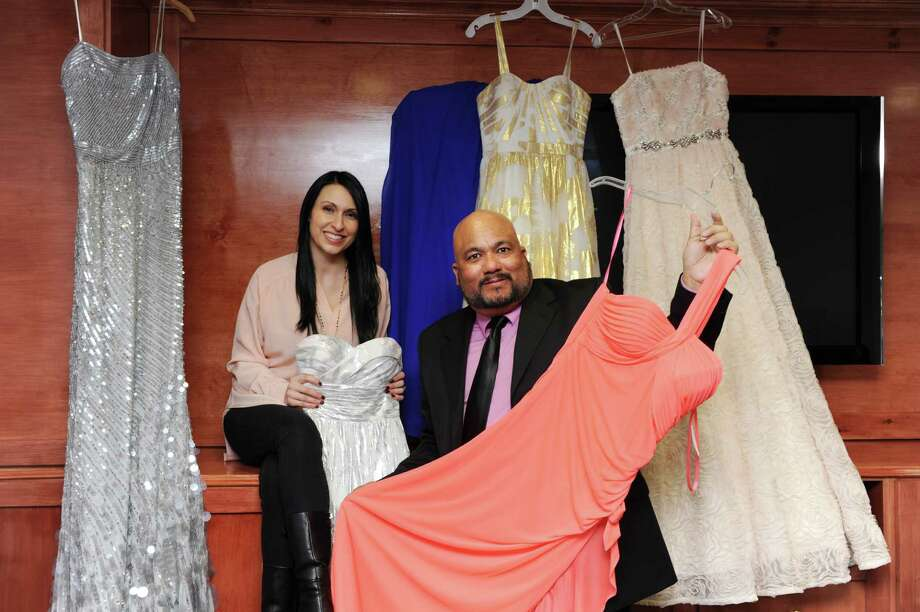 Noel D'Allacco, founder of Operation Prom, and Connecticut chapter president Armand Perez pose with some of the dresses they have for young women who can't otherwise afford them in Darien, Conn. on Monday February 24, 2014. Photo: Dru Nadler / Stamford Advocate Freelance