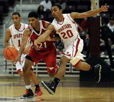North Shore's Brandon Green, left, and Cy-Lakes' Xante Wallace chase a loose ball during the second half of the Class 5A Region 3 semifinal high school basketball playoff game, Friday, February 28, 2014, at Campbell Center in Houston. Photo: Eric Christian Smith, For The Chronicle