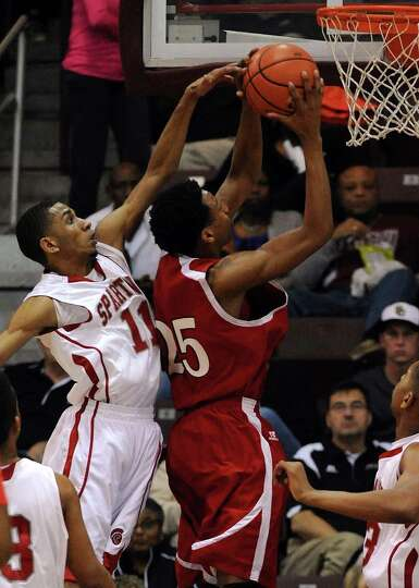 North Shore's Jarrey Foster, right, shoots the ball as Cy-Lakes' Jonathan Bradley defends during the