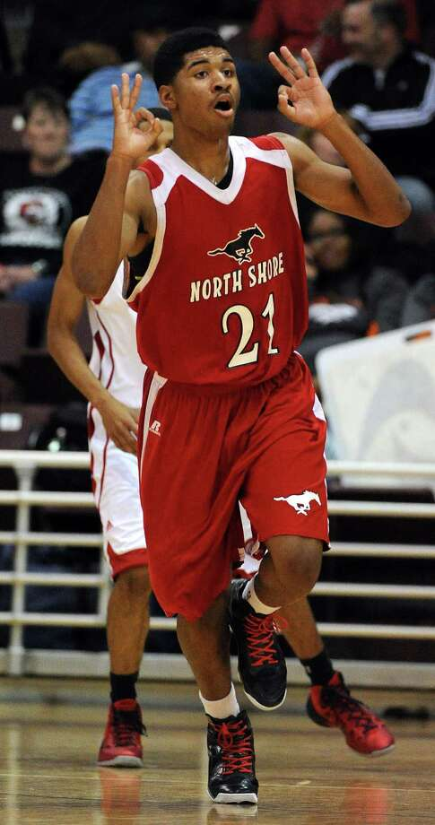 North Shore's Jordan Banks signals his three-pointer during the first half of the Class 5A Region 3 semifinal high school basketball playoff game against Cy-Lakes, Friday, February 28, 2014, at Campbell Center in Houston. Photo: Eric Christian Smith, For The Chronicle