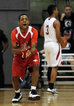 North Shore's Brandon Etienne celebrates a Mustangs' three-pointer during the first half of the Class 5A Region 3 semifinal high school basketball playoff game agains Cy-Lakes, Friday, February 28, 2014, at Campbell Center in Houston. Photo: Eric Christian Smith, For The Chronicle