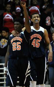 Bush's  Brandon Jones (25) celebrates the Broncos' 60-59 victory over Cy-Woods with teammate Eden Ewing in the Class 5A Region 3 semifinal high school basketball playoff game, Friday, February 28, 2014, at Campbell Center in Houston. (Photo: Eric Christian Smith/For the Chronicle Photo: Eric Christian Smith, For The Chronicle