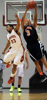 Bush's Brendon Ganaway (3) and Cy-Woods' Josh Samuels fight for an inbound pass during the second half of the Class 5A Region 3 semifinal high school basketball playoff game, Friday, February 28, 2014, at Campbell Center in Houston. Photo: Eric Christian Smith, For The Chronicle