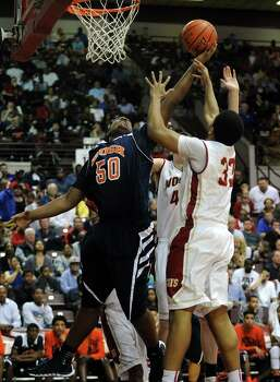 Bush's Joshua Jones (50) fights for a rebound with Cy-Woods' Kellen Johnson (33) during the second half of the Class 5A Region 3 semifinal high school basketball playoff game, Friday, February 28, 2014, at Campbell Center in Houston. Photo: Eric Christian Smith, For The Chronicle