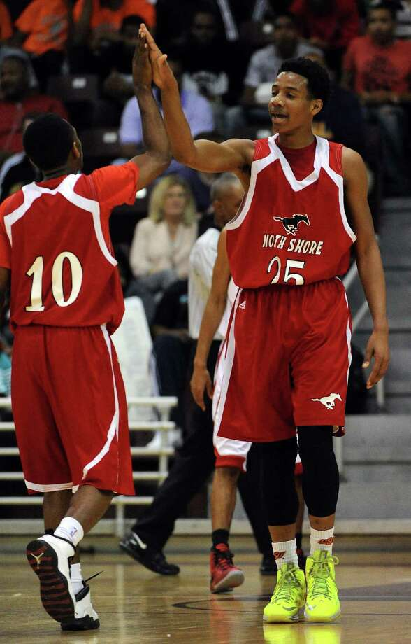 North Shore's Jarrey Foster (25) and Brandon Etienne celebrate a Mustangs' two-pointer during the first half of the Class 5A Region 3 semifinal high school basketball playoff game against Cy-Lakes, Friday, February 28, 2014, at Campbell Center in Houston. Photo: Eric Christian Smith, For The Chronicle
