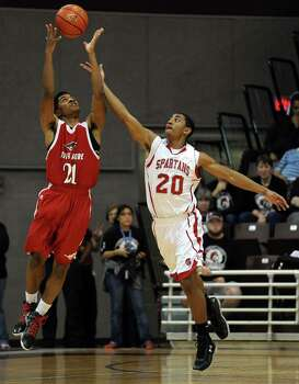 North Shore's Brandon Green, left, and Cy-Lakes' Xante Wallace fight for an inbound pass during the first half of the Class 5A Region 3 semifinal high school basketball playoff game, Friday, February 28, 2014, at Campbell Center in Houston. Photo: Eric Christian Smith, For The Chronicle