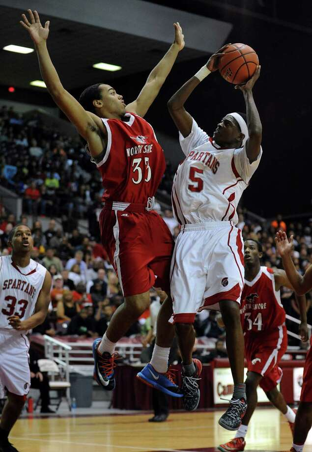 Cy-Lakes' De'Aaron Fox (5) shoots the ball as North Shore's Chukumeke defends during the first half of the Class 5A Region 3 semifinal high school basketball playoff game, Friday, February 28, 2014, at Campbell Center in Houston. Photo: Eric Christian Smith, For The Chronicle
