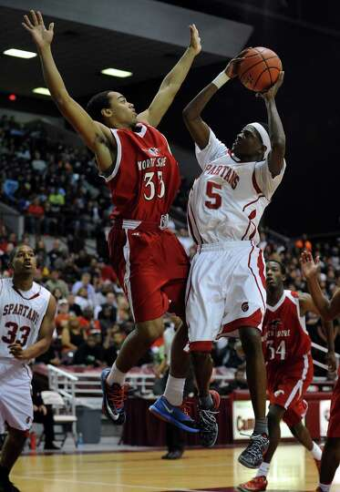 Cy-Lakes' De'Aaron Fox (5) shoots the ball as North Shore's Chukumeke defends during the first half