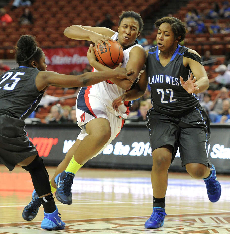Manvel's Rangie Bessard (35) and Plano West's Sydney Skinner (35) and Kaelin Domingeaux (22) during the UIL 5A state semifinal girls basketball game between Manvel and Plano West high schools on Fri., Feb. 28, 2014 at the Frank Erwin Center in Austin, TX. Photo: Ashley Landis, Special Contributor / ©Ashley Landis