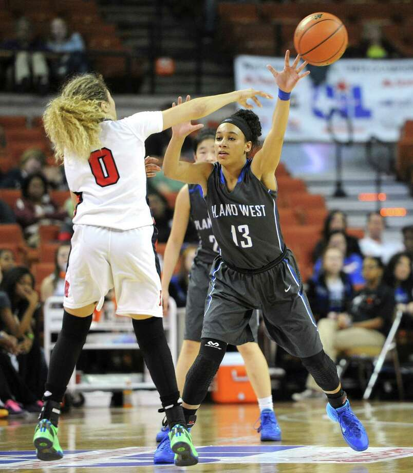 Manvel's Amieya Jackson (0) and Plano West's Callie Owens (13) during the UIL 5A state semifinal girls basketball game between Manvel and Plano West high schools on Fri., Feb. 28, 2014 at the Frank Erwin Center in Austin, TX. Photo: Ashley Landis, Special Contributor / ©Ashley Landis