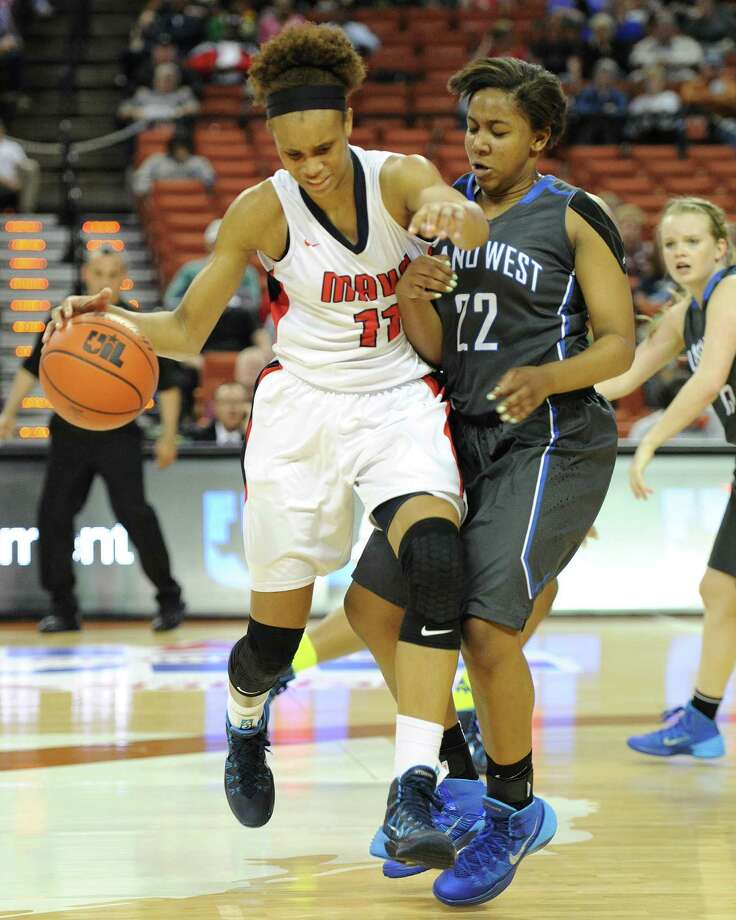 Manvel's Brianna Turner (11) and Plano West's Kaelin Domingueax (22) during the UIL 5A state semifinal girls basketball game between Manvel and Plano West high schools on Fri., Feb. 28, 2014 at the Frank Erwin Center in Austin, TX. Photo: Ashley Landis, Special Contributor / ©Ashley Landis