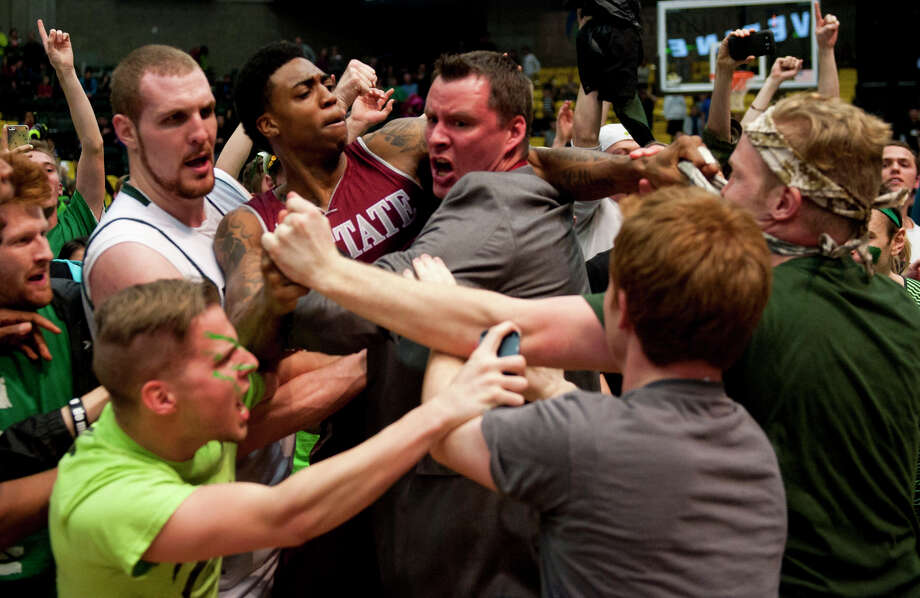 New Mexico State's Daniel Mullings, center left, finds himself embroiled in an on-court brawl after Thursday's game at Utah Valley in Orem, Utah. Photo: Grant Hindsley, MBO / The Daily Herald