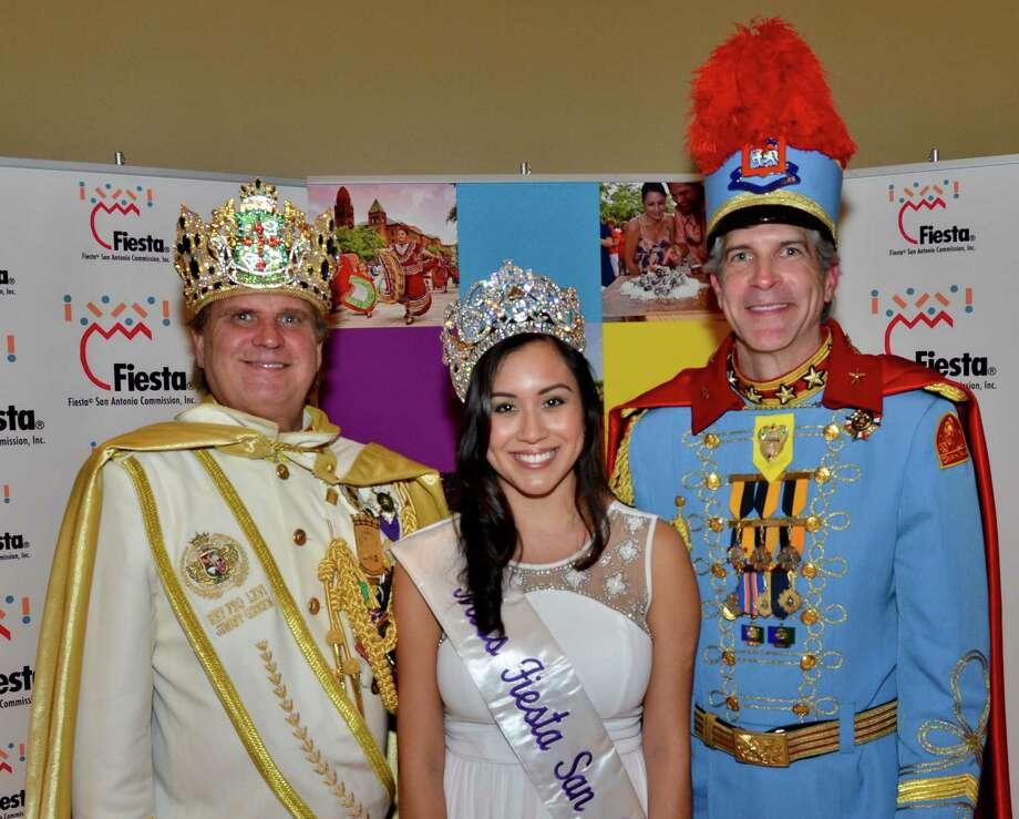 Miss Fiesta 2104 Sophia Campos joins other Fiesta royalty, El Rey Feo Jimmy Green (left) and King Antonio De Miller. Photo: Courtesy Photo / San Antonio Express-News