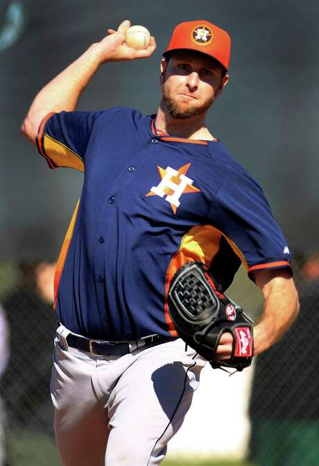 At 31, Scott Feldman believes he is just now reaching his peak as a pitcher, which is good news for the Astros. Photo: Karen Warren, Staff / © 2013 Houston Chronicle