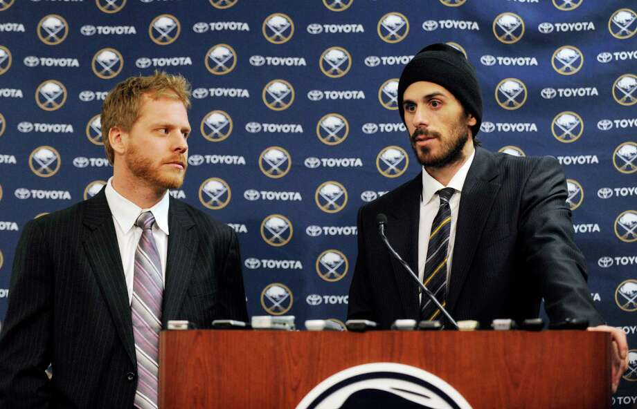 Former Buffalo Sabres forward Steve Ott, left, and goaltender Ryan Miller talk about their future after a trade that sent them to the St. Louis Blues, in Buffalo, N.Y., Friday, Feb. 28, 2014. (AP Photo/Gary Wiepert) ORG XMIT: NYGW112 Photo: Gary Wiepert / FR170498 AP