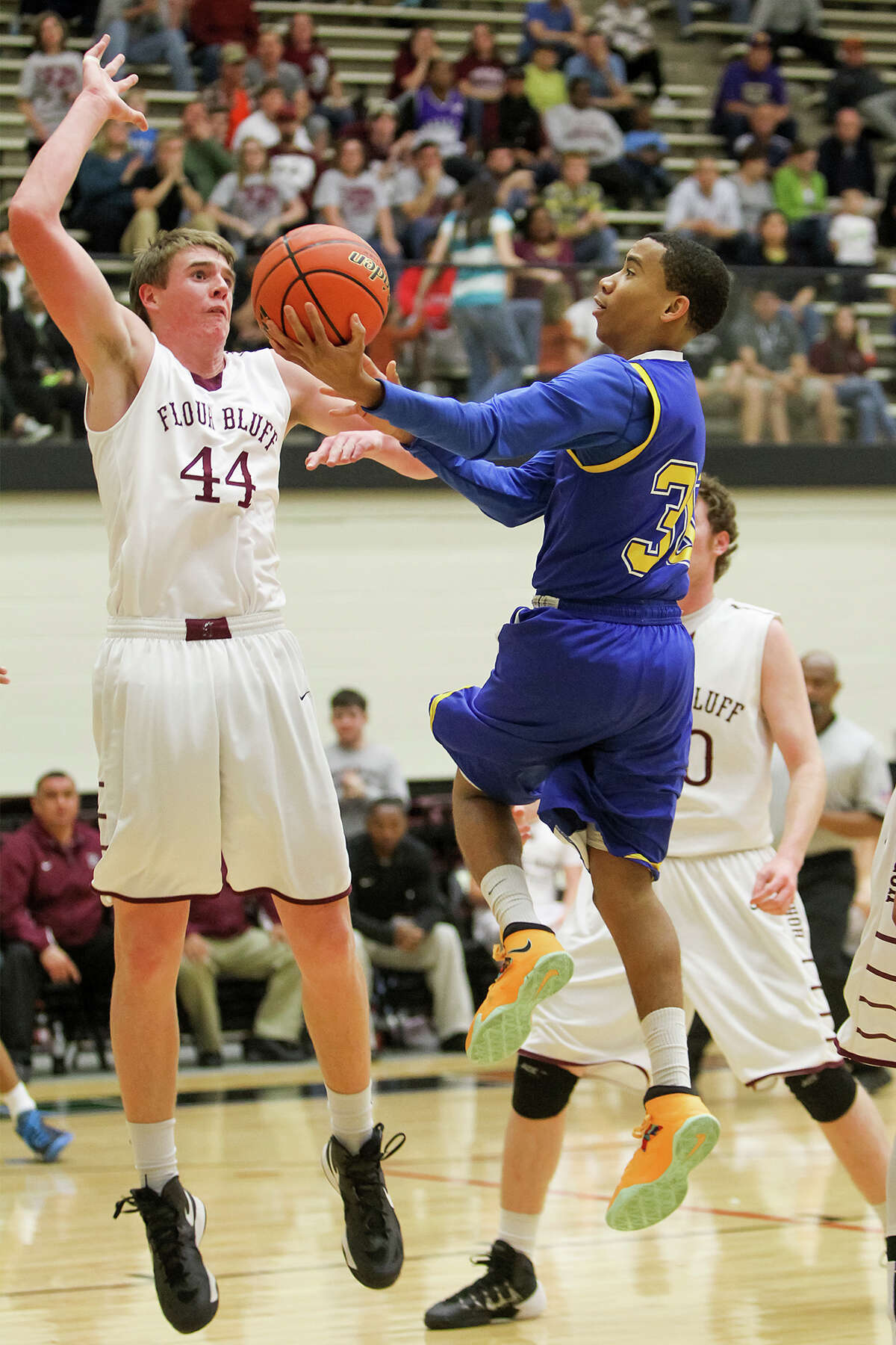 Clemens' Juway Strom (right) shoots over Corpus Christi Flour Bluff's Cody Brewer (left) during the first half of their Region IV-4A semifinal game at Littleton Gym on Friday, Feb. 28, 2014. Clemens beat the Hornets 75-50. MARVIN PFEIFFER/ mpfeiffer@express-news.net