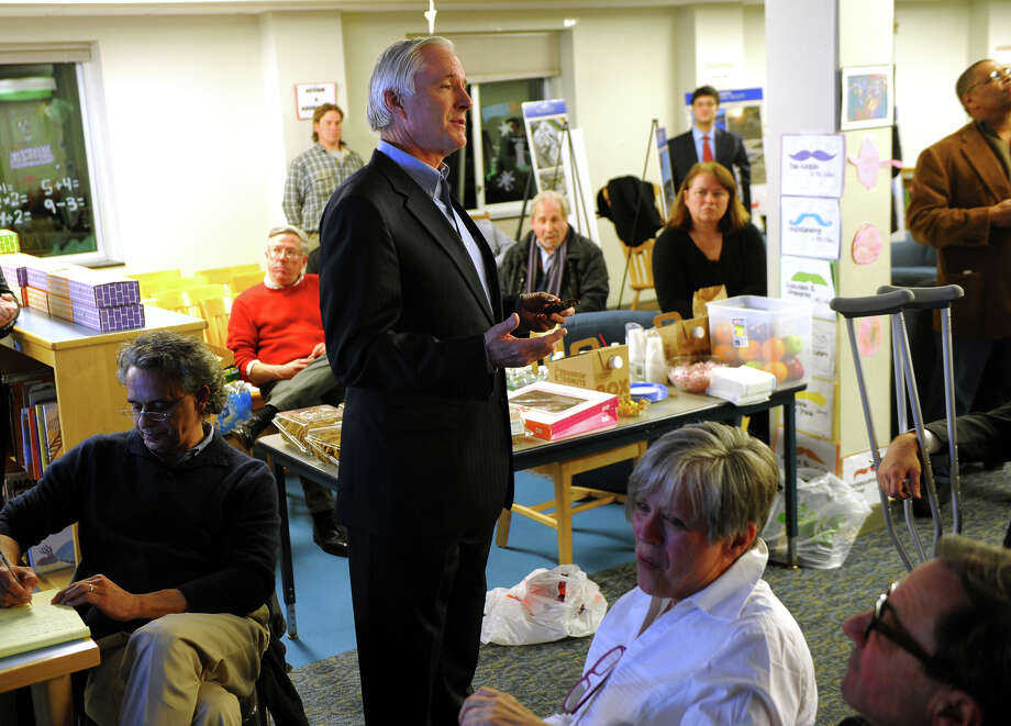 Mayor Bill Finch addresses residents as he and members of the City Council host a public forum Thursday, Feb. 6, 2014, for a United Illuminating proposal to install 9,000 solar panels on top of the old landfill next to Seaside Park. Finch is lobbying to resurrect the proposal, which was rejected last month by the Parks Commission. Photo: Christian Abraham / Connecticut Post