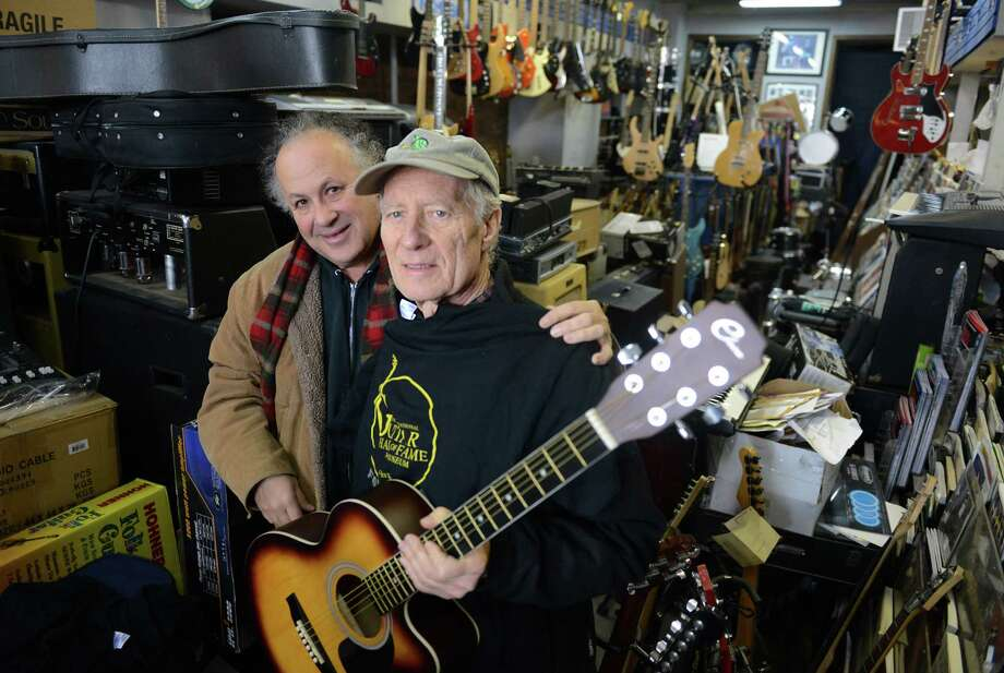 Guitarist Arlen Roth, left, and Music Guild store owner Russ Mumma stand in the store in Danbury on Thursday. Mumma is giving 15 guitars to Roth so he can give them to inner-city children in Asbury Park, N.J., as part of his plan to establish the International Guitar Hall of Fame and Museum in Asbury Park and spread the love of music in the community. Photo: Tyler Sizemore / The News-Times