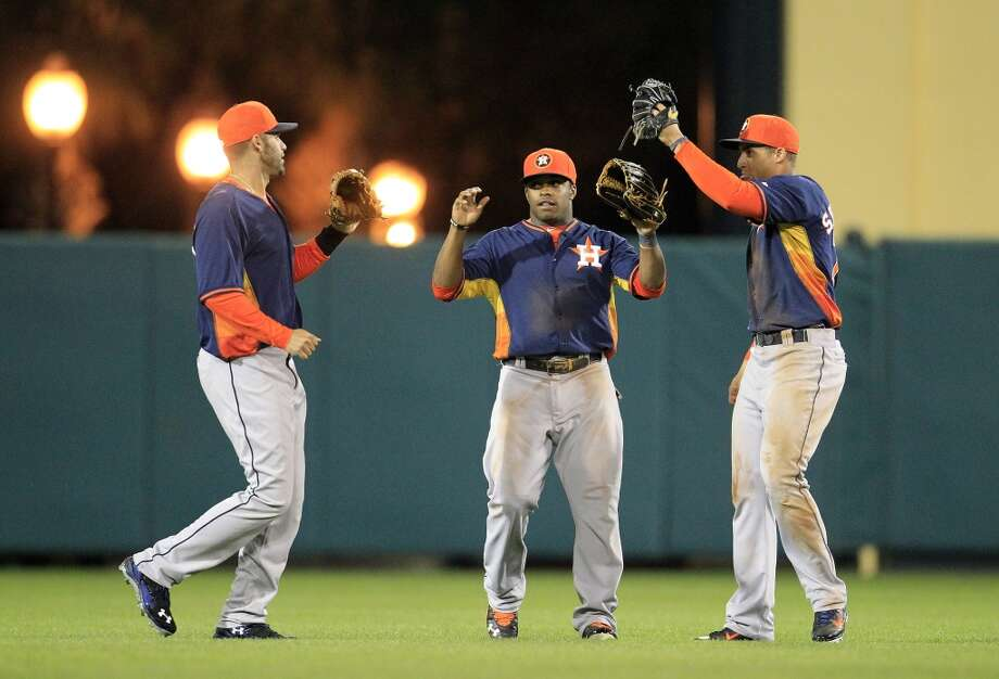 J.D. Martinez (20), Delino DeShields (80) and George Springer (79) celebrate the win. Photo: Karen Warren, Houston Chronicle