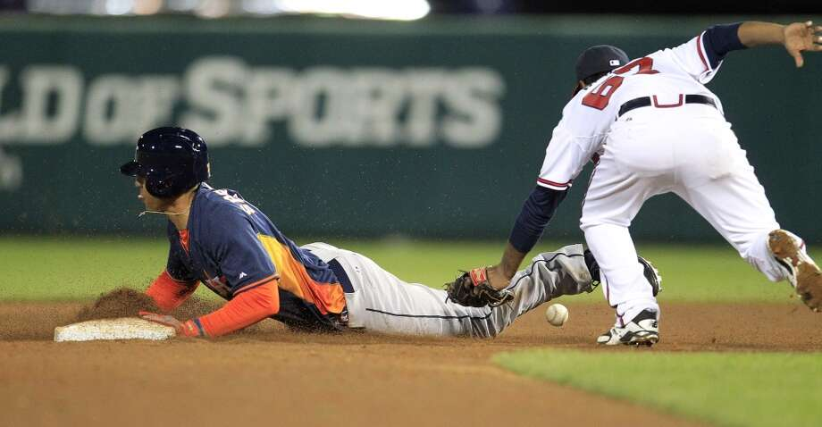 George Springer steals second base. Photo: Karen Warren, Houston Chronicle