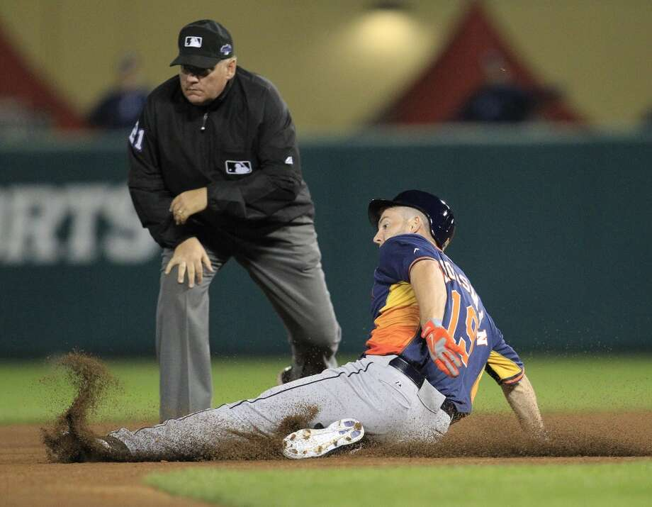 Robbie Grossman kicks up dirt as he slides into second base. Photo: Karen Warren, Houston Chronicle