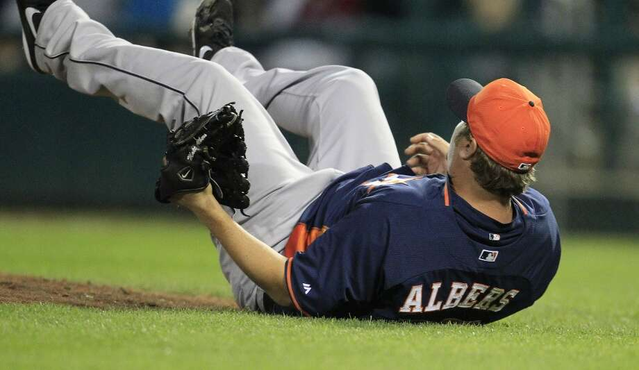 Astros RHP Matt Albers hits the ground after a come-backer from Atlanta's Freddie Freeman. Photo: Karen Warren, Houston Chronicle