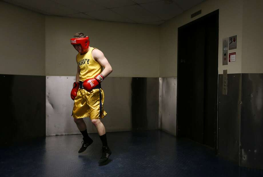 United States Naval Academy midshipman Ben Matson warms up in a hallway before his bout in the Brigade Boxing Championships in Annapolis, Md., Friday, Feb. 28, 2014. The academy has offered boxing since 1865, both as a club sport as well as a required part of the physical education program. (AP Photo/Patrick Semansky) Photo: Patrick Semansky, Associated Press