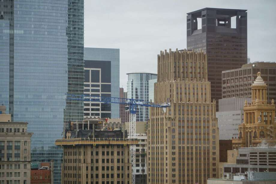 Construction cranes have become a common sight in downtown Houston, which is one of Coretrust Capital Partners' target areas. Photo: Michael Paulsen, Staff / © 2014 Houston Chronicle