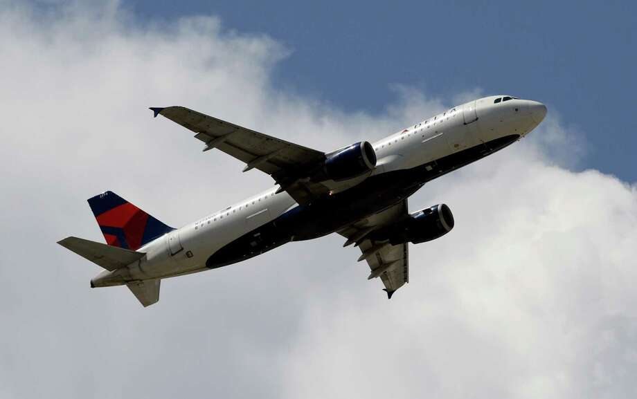 Delta Air Lines says that starting Jan. 1, it will reward passengers for the amount they spend on tickets, not the number of miles they fly. Photo: Alan Diaz, STF / AP