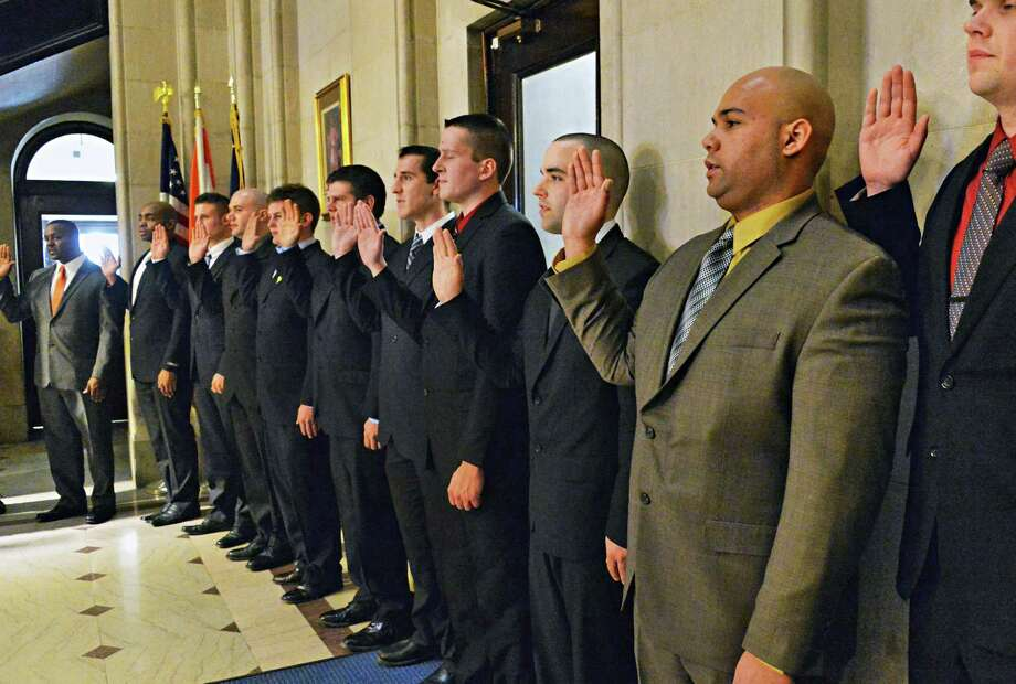 New Albany recruit firefighters are sworn in to the Department of Fire & Emergency Services during  a ceremony Friday, Feb. 28, 2014, at City Hall in Albany, N.Y.  (John Carl D'Annibale / Times Union) Photo: John Carl D'Annibale / 00025948A
