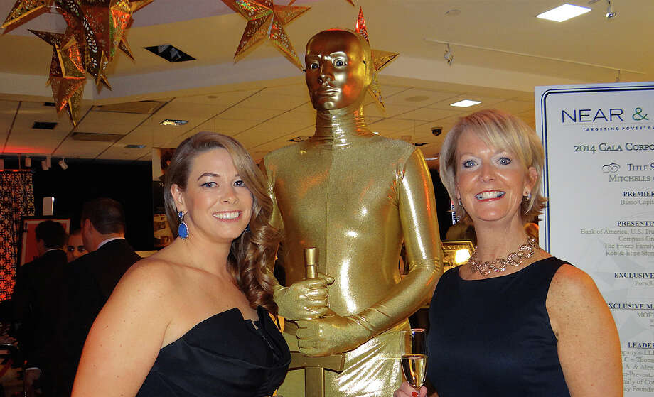 "Sarah Hale and Mary Thornton, with a ""live"" Oscar statuette, were the co-chairwomen of Near & Far Aid's Spring Gala at Mitchells of Westport on Friday night. Photo: Mike Lauterborn / Westport News contributed"