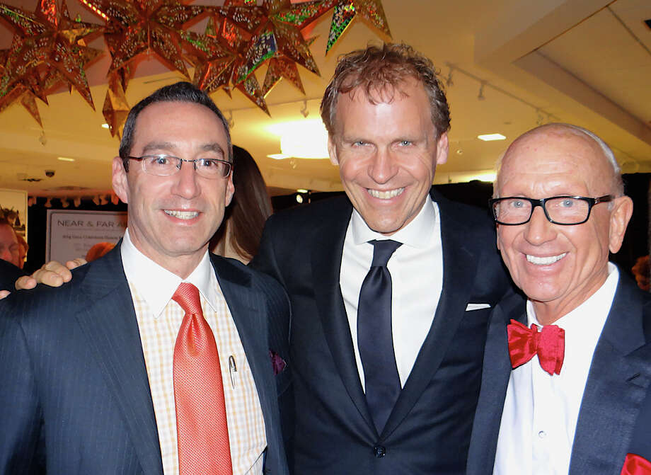 John Resnick, left, general manager of Porsche of Fairfield, with Bob and Bill Mitchell at Near & Far Aid's Spring Gala at Mitchells of Westport on Friday night. Photo: Mike Lauterborn / Westport News contributed