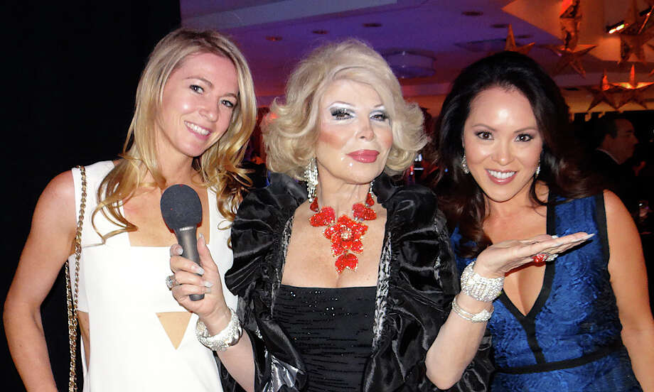 Kelly Scinto of Fairfield and Kim Meier of Westport, with Joan Rivers impersonator Linda Axelrod, at Near & Far Aid's Spring Gala on Friday. Photo: Mike Lauterborn / Westport News contributed