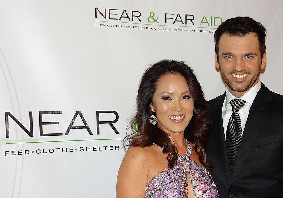 "Near & Far Aid board member Kim Meier and ""Dancing with the Stars"" personality Tony Dovolani at Near & Far Aid's Spring Gala at Mitchells of Westport on Friday night. Photo: Mike Lauterborn / Westport News contributed"