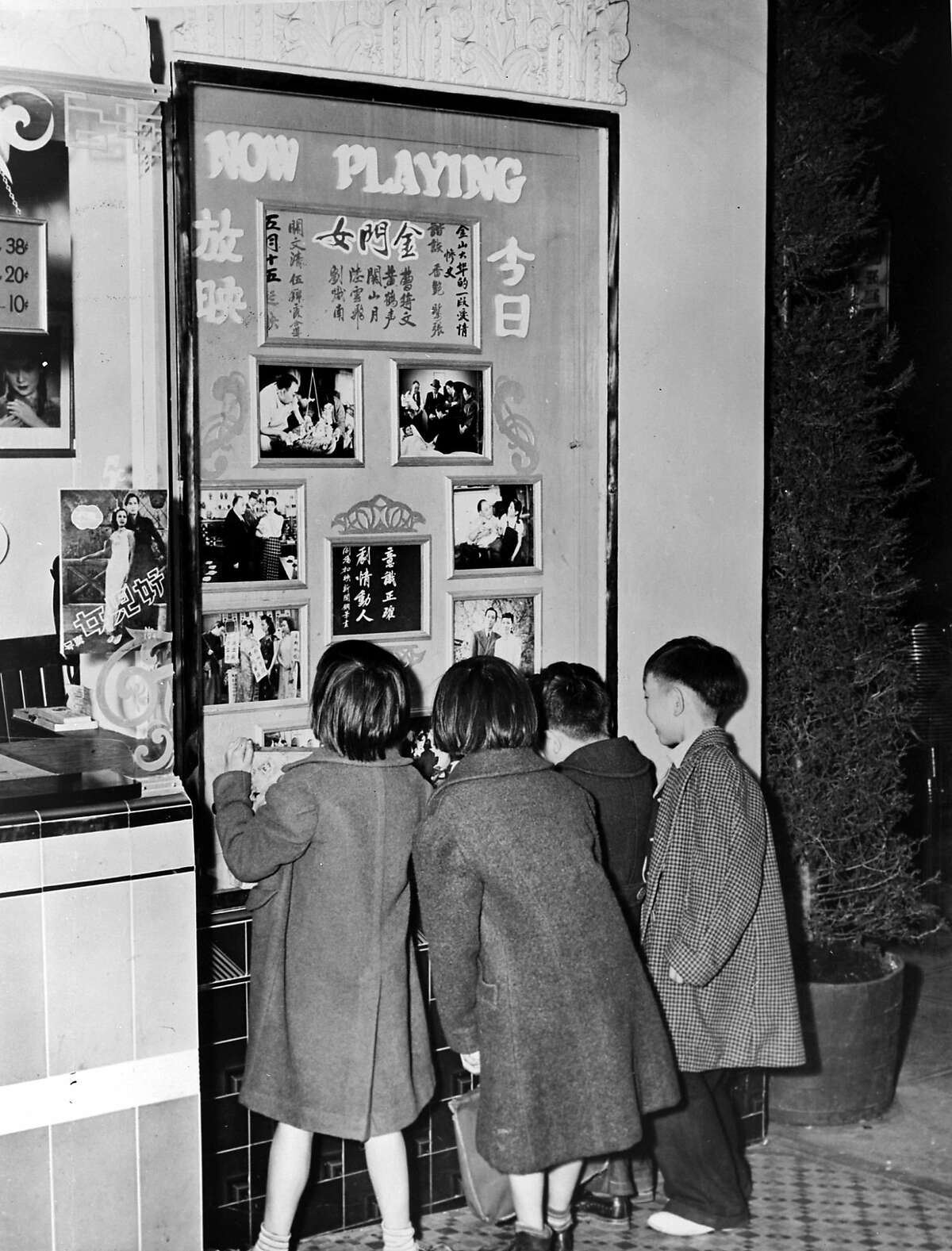 Kids checking out the Grandview Theater marquee in Chinatown 1944. From Arthur Dong's documentary