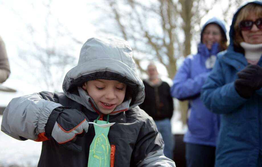 Six-year-old Gaetan Grech, of Bridgeport, tastes fresh maple syrup from Greg Karas, of Ansonia, Saturday, Mar. 1, 2014, during the Ansonia Nature Center's Maple Festival in Ansonia, Conn. Photo: Autumn Driscoll / Connecticut Post