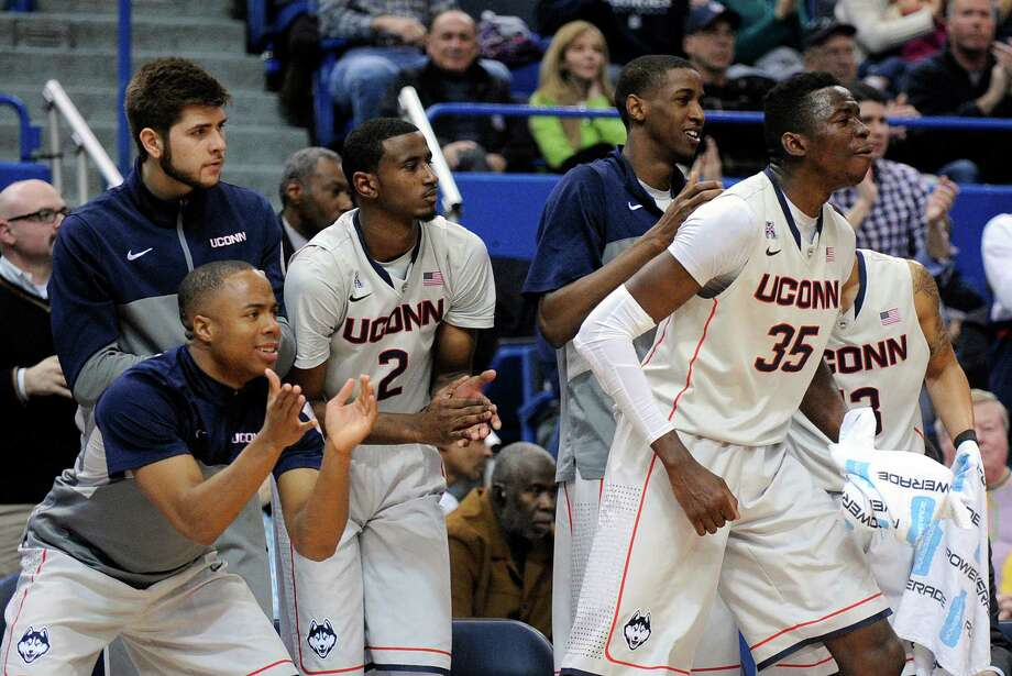 Connecticut players react during the second half of their team's 51-45 victory over Cincinnati in an NCAA college basketball game in Hartford, Conn., Sunday, March 1, 2014. Photo: Fred Beckham, AP / Associated Press